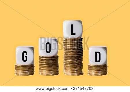 Sudden Falling Value In Investment Plan In Price Of Gold With Blocks On Stacks Of Gold Coins On Gold