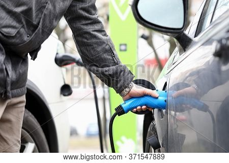 Man Fills Equipment Car Tank With Fuel Gas Station. Demand For Petroleum Products During Quarantine