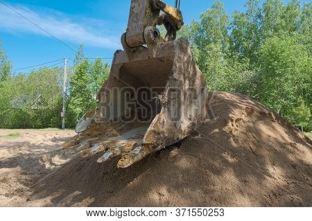 Excavator Digs Clay Soil At The Construction Site