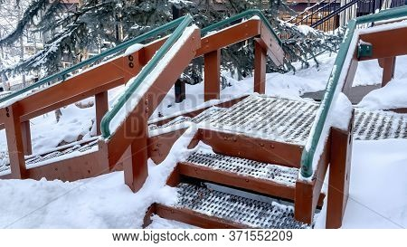 Panorama Stairs With Green Handrails And Grate Metal Treads Built On Hill With Fresh Snow