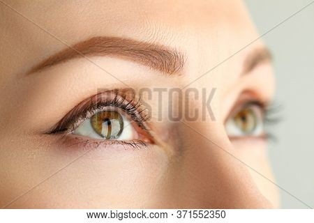 Close-up Face Model Permanent Makeup Eyebrows. Girl Is Ready To Transform Her Face. Natural Eyebrows