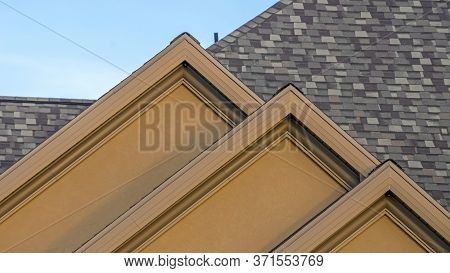 Panorama House Exterior With Front Gable Roof Design Against Blue Sky Background
