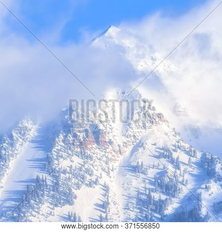 Square Steep Peak Of The Magnificent Wasatch Mountains Covered With Snow In Winter