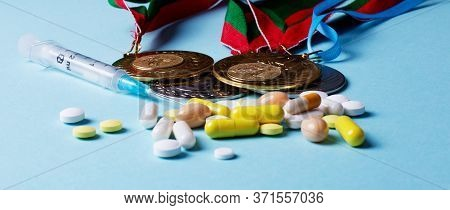 Syringe, Pills And Medals On A Blue Background. Doping In Sports. Abuse Of Anabolic Steroids For Spo