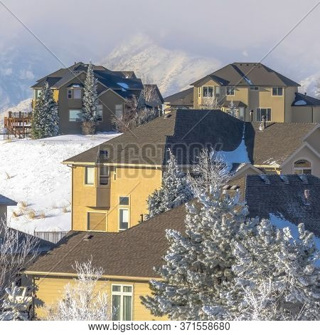 Square Crop Houses On Snow Covered Wasatch Mountain Setting On A Sunny Winter Day