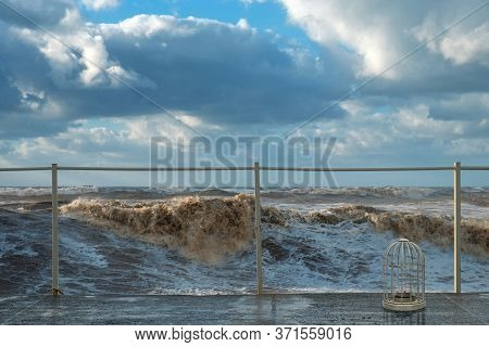Muddy Sea Waves With Spray And Foam During Storm At The Sea With Cloudy Sky Background