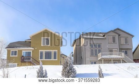 Panorama Facade Of Homes That Sit On The Snow Covered Slope Of Wasatch Mountain In Winter