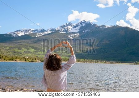 Happy Woman Spread Her Arms Enjoying Nature And Relaxation (rear View) Brunette Girl Relaxes In The