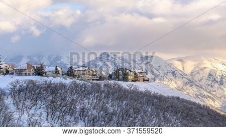 Panorama Picturesque Wasatch Mountains View With Houses On A Snowy Setting In Winter