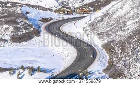 Panorama Wasatch Mountain Landscape With Road And Houses On Snowy Residential Community