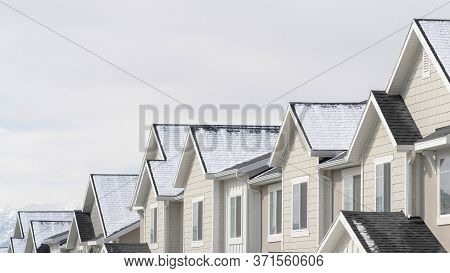 Panorama Townhouses With Snowy Gable Roofs In South Jordan Utah On A Cloudy Winter Day