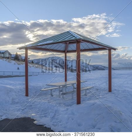 Square Crop Pavilion On The Seewping Snow Covered Terrain Of Wasatch Mountain In Winter