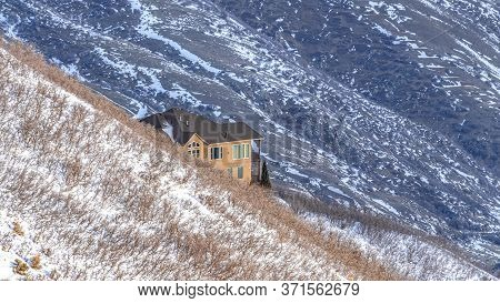 Panorama Home Amidst Sweeping Terrain Of Wasatch Mountains Blanketed With Snow In Winter