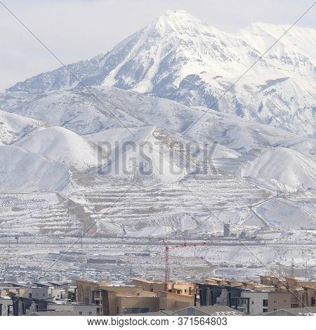 Square Crop Snowy Wasatch Mountain Towering Over The Neighborhood Of South Jordan In Utah