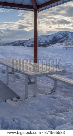 Vertical Frame Small Pavilion With A Single Picnic Table With Seats With Wasatch Mountain View