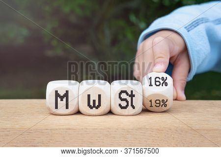Duty And Taxes. German Tax Cut On Value-added Tax (vat). Wooden Blocks With One Inverted Block. Vat
