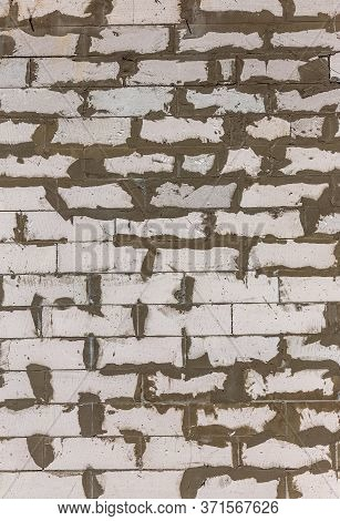Creative Background White Silicate Brick Wall With Traces Of Cement Mortar For Cementing Bricks. Whi