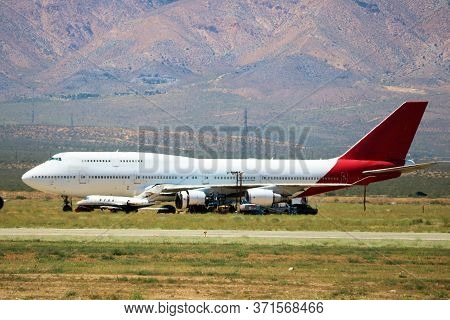 June 10, 2020 In Mojave, Ca:  Retired Commercial 747 Aircraft Stored On The Airfield To Be Resold Ta
