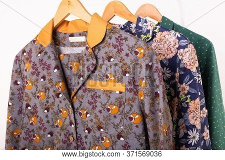 Clothing Retails Concept. Ladies Pajamas On Hangers In Clothes Store Close-up. Pajama In Shop. Adver