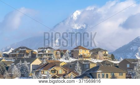 Panorama Frame Houses With Magnificent View Of Wasatch Mountain Peak Against Cloudy Blue Sky