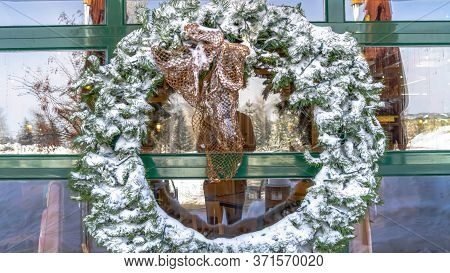 Panorama Snowy Leafy Wreath Hanging On The Glass Wall Of A Building In Wasatch Mountains