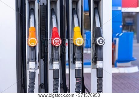 Service Gas Station With Fuel, Oil, Gasoline And Diesel, Side View. Close-up Of A Gas Pump Fueling G