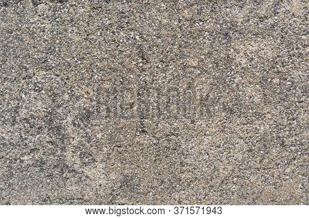 Old Concrete Wall With Bumps And Cracks. Gray Abstract Background