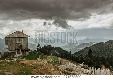 Abandoned Wooden House.old Homestead Home In A Remote Area. Amazing View Of The Mountains And Wild N