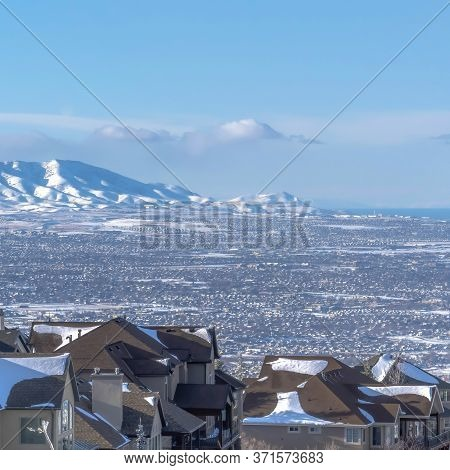 Square Luxury Homes On Snowy Slope Overlooking The Valley And Wasatch Mountain
