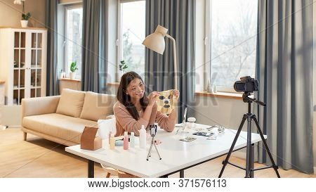 Female Blogger Recording A Tutorial Video For Her Beauty Blog About Skincare Routine. Focus On A Gir