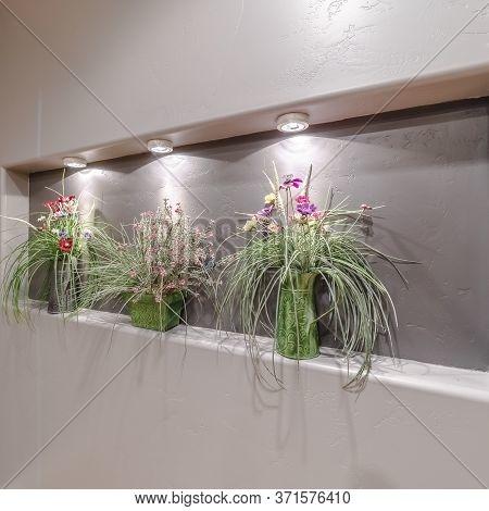 Square Flower Arrangements In A Recessed Alcove Interior