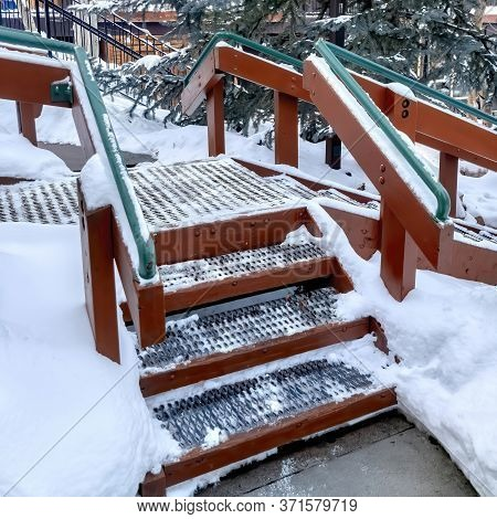 Square Crop Stairs With Green Handrails And Grate Metal Treads Built On Hill With Fresh Snow