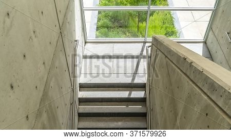 Panorama View From Above Of Concrete Stairway With Metal Handrails Inside Of Building
