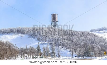 Panorama Paved Road On The Snowy Slopes Of Wasatch Mountains With Cloudy Blue Sky View