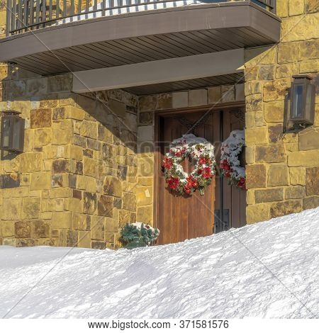 Square Double Door Decorated With Wreath At The Entrance Of Home In Wasatch Mountains