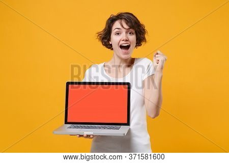 Excited Young Brunette Woman In White T-shirt Posing Isolated On Yellow Background. People Lifestyle