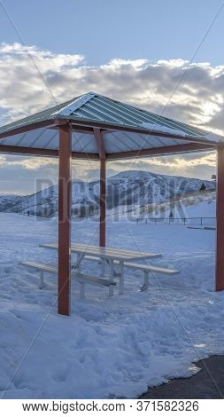 Vertical Pavilion On The Seewping Snow Covered Terrain Of Wasatch Mountain In Winter