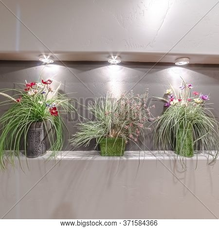 Square Three Flower Arrangements In A Wall Alcove