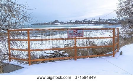 Panorama Scenic Utah Lake In Winter With No Trespassing Sign A Fence In The Foreground