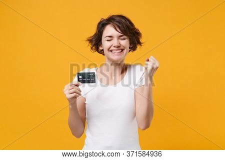 Smiling Young Brunette Woman Girl In White T-shirt Isolated On Yellow Orange Background. People Life