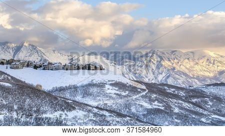 Panorama Panoramic View Of Homes Situated Amidst Striking Wasatch Mountains In Winter
