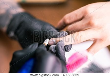 Close-up Of Hardware Milling Cutter For Removing Gel Polish. Apparatus Manicure In Beauty Salon. Man