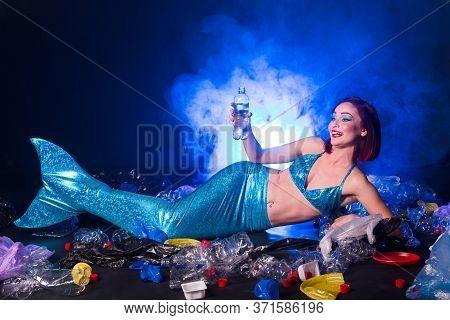 Ocean Pollution, Rubbish In The Water. Stupid Fairytale Mermaid In Dirty Ocean. Plastic Trash And Ga