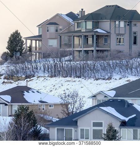 Square Frame Houses On Snowy Setting In Winter With Magnificent View Of Wasatch Mountain