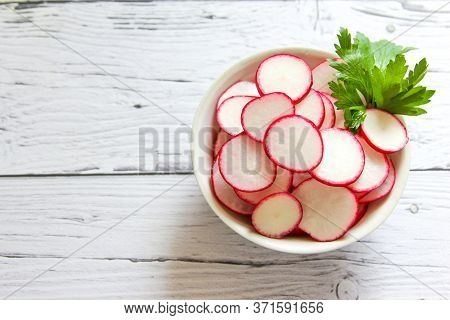 Closeup Radish Slices In The Bowl. Raw Radish Slices Ready To Eat.