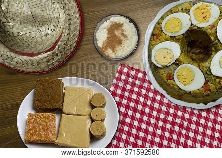 Typical Brazilian Junina Party Food And Sweets. Couscouz, Peanut Candy, Sweet Rice, Dulces De Leche