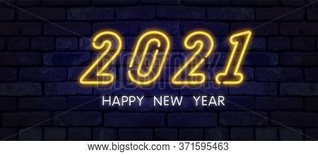 2021 Happy New Year Neon Banner. Realistic Bright Neon Billboard On Brick Wall. Concept Of Holiday C