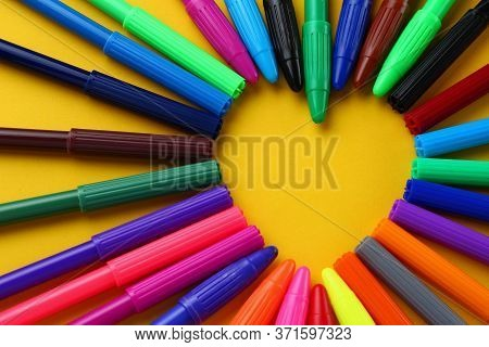 Felt Pens Of Different Colors Form A Heart-shaped Frame For Text Or Lettering. Background With Copys