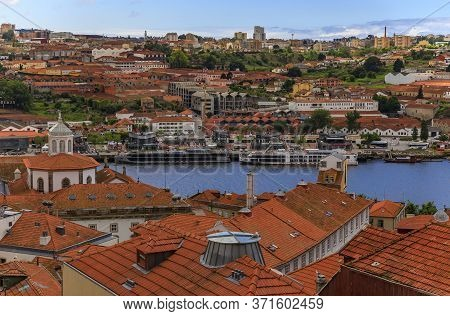 Porto, Portugal - June 1, 2018: View Over The Red Terracotta Roofs Across The Douro River Onto Facad