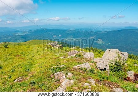 Mountain Summer Landscape. Meadow With Stones In The Grass On Top Of The Hillside Near The Summit